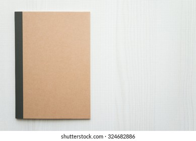 Blank empty notepad on white wood table