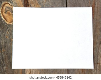 Blank or empty piece of paper on a rustic wood table for a vintage concept