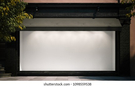 Blank empty shop window in the night street with light on the frame. 3d rendering