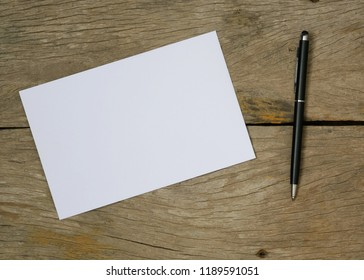Blank Envelope On Wooden Background Top ViewWith Copy Space