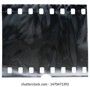 blank and exposed 35mm filmstrip with foil texture on white background, film material type 135
