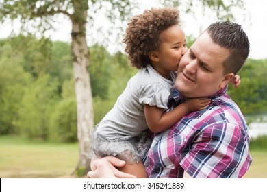 Blank father with his african daugther having a nice time