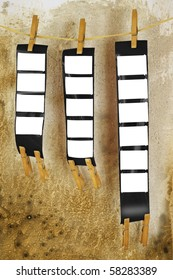 blank film strips, against grungy background, empty frames, free picture or copy space