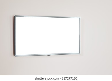 Blank flat TV screen hanging at the wall