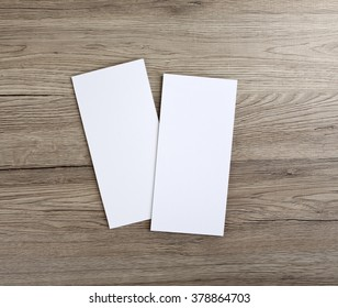 Blank flyer over wooden background to replace your design