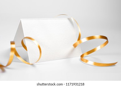 Blank folded thank you or greeting card decorated with gold ribbon