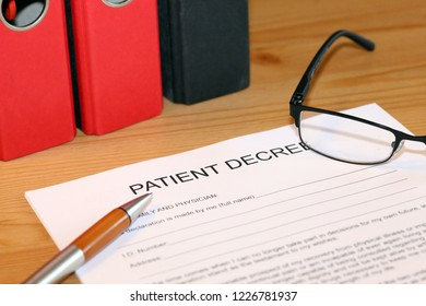 Blank form of a patient decree on a desk
