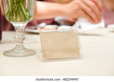 Blank frame on table in restaurant cafe shop