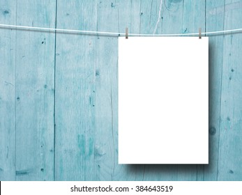 Blank frame with pegs on aqua weathered wooden boards background
