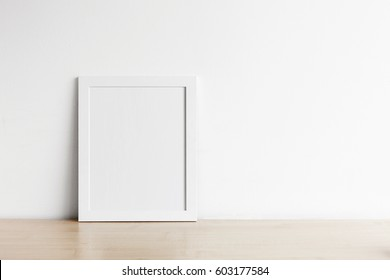 Blank frame photo on wood table with copy space