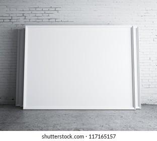blank frames in concrete room
