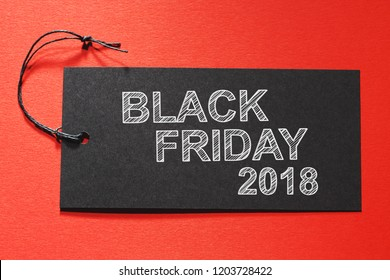 Blank Friday 2018 text on a black tag on a red paper background