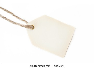 Blank gift tag with an old piece of string and shot on a white background.  Room for text.