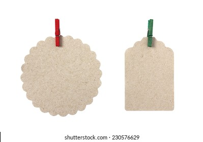 Blank gift tags made from brown eco-friendly kraft paper in different shapes with red and green peg - isolated on white background