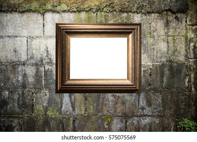 Blank golden frame on dirty wall