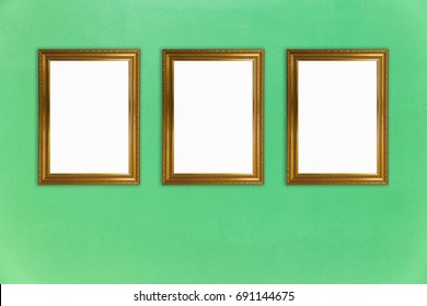 Blank golden vintage photo frames collage on green cement wall, interior mock up, blank photo frames and texture for add text or graphic design, interior concept design
