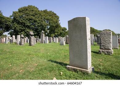 Blank gravestone in graveyard during the summer season