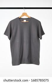Blank gray T-Shirt Mock-up hanging on white background.