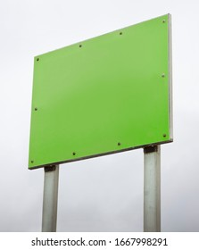 Blank green advertising sign. Empty billboard background for text.