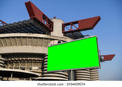 Blank green billboard outside stadium for new advertisement. Ideal for football, soccer, sport related ads. Milan, Italy