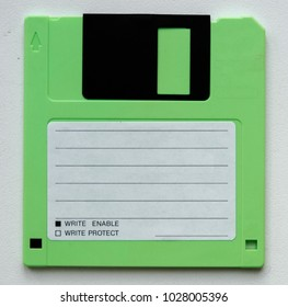 Blank green floppy disk on white background. Easy adjustable colour in editor.