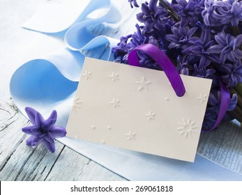 blank greeting card with fresh purple flowers