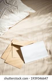 blank greeting card  invitation mockup with craft paper envelope  feminine still life composition