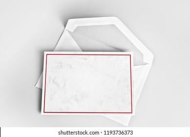 Blank greeting or thank you card with red frame over envelope