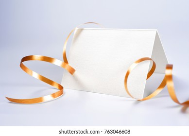 Blank greeting or thank you card decorated with yellow ribbon
