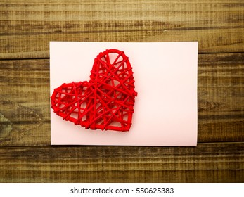 blank greetings with Valentine's day, women's day, on wooden background with red heart and flowers