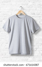 Blank Grey T-Shirt Mock-up hanging on white wall, front  side view . Ready to replace your design