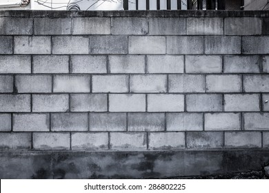 A blank, grungy cinder block wall, perfect for background and messages.