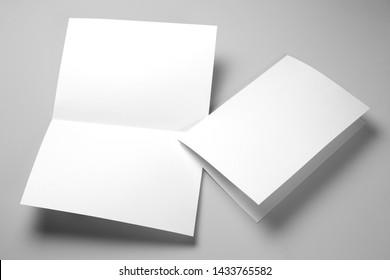 Blank half-folded booklet, postcard, flyer or brochure mockup template on gray background