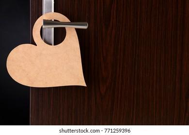 blank heart shape door sign hanging at door handle