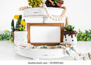 Blank horizontal wood sign on tier tray with succulents, rustic farmhouse style decoration mockup  - Shutterstock ID 1919091341