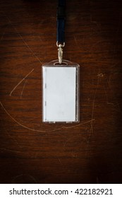 blank id card on wood background