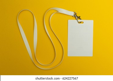 Blank identification card with white neckband isolated on yellow background, space for text.