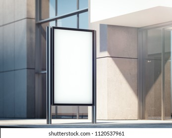 Blank illuminated banner on a street with business center on background. 3d rendering