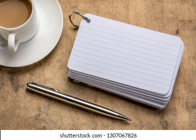 blank index cards with a cup of coffee and   apen