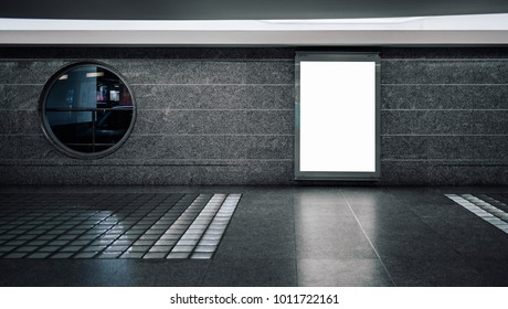 Blank informational billboard with clean white space for publicity content or advertising in modern pedestrian subway, vertical template of board with screen mock-up in interior of underground passage