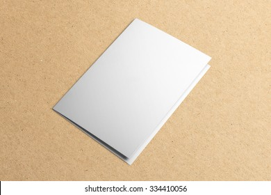 Blank invitation, greeting card, isolated on cardboard background, with clipping path, changeable background