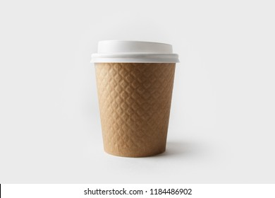 Blank kraft paper coffee cup with cap. Disposable cup