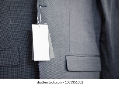 Blank label on new suit jacket close-up