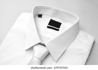 Blank label on white shirt, isolated background