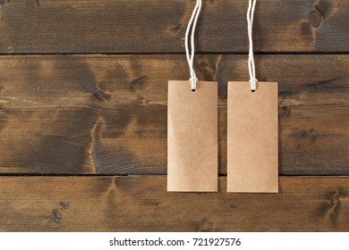 Blank labels tags with string on a rustic wooden table
