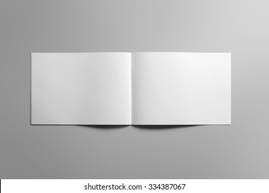 Blank landscape brochure magazine isolated on cardboard background, with clipping path, changeable background