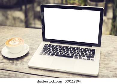 Blank laptop and cup of coffee outdoors, mock up