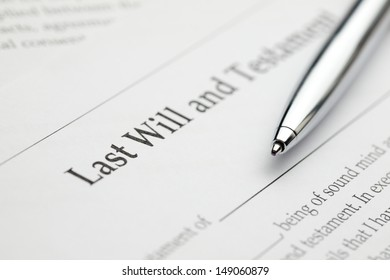 A blank last will and testament form with a pen laying over it.