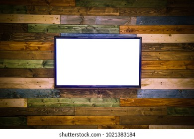 Blank lcd Flat screen television hanging at the planks wooden wall with copy space in living room or bedroom on color wooden wall.