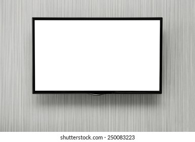 Blank lcd TV hanging at the wall with copy space and clipping path for the screen